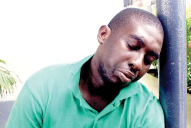 Akolade Arowolo, who allegedly killed his banker wife