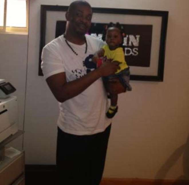 Don Jazzy with his god-daughter, Princess Michelle