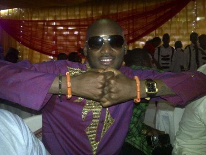2Face displays his royal beads