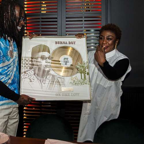 burna boy receives gold plaque as on the low goes gold in france